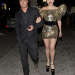 Lady Gaga and her fiancé Taylor Kinney were seen walking two full blocks to 'No Name ' Restaurant to celebrate Gaga's birthday party in Los Angeles, CA. A man was seen arriving with a piece of Artwork that gaga requested that was drawn by Michael Jackson and valued at $2 Million dollars. Gaga was wearing very large wedge heel shoes and a Gold Dress with wings on the shoulders while Taylor opted for a nice dress suit.  Pictured: Lady Gaga, Taylor Kinney Ref: SPL1252756  270316   Picture by: SPW / TwisT / Splash News  Splash News and Pictures Los Angeles:310-821-2666 New York:212-619-2666 London:870-934-2666 photodesk@splashnews.com